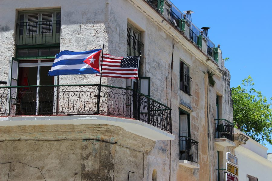 Photo of the Cuban and USA flags on a balcony