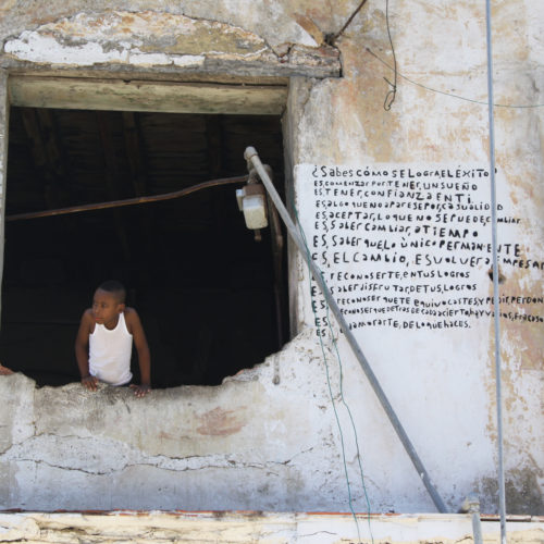 Photo of a young boy in a window in Cuba