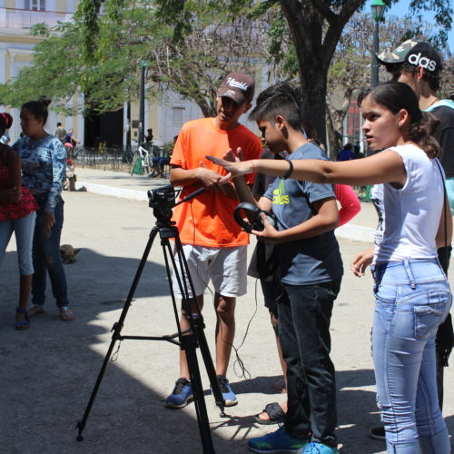 Group of young people filming in Cuba