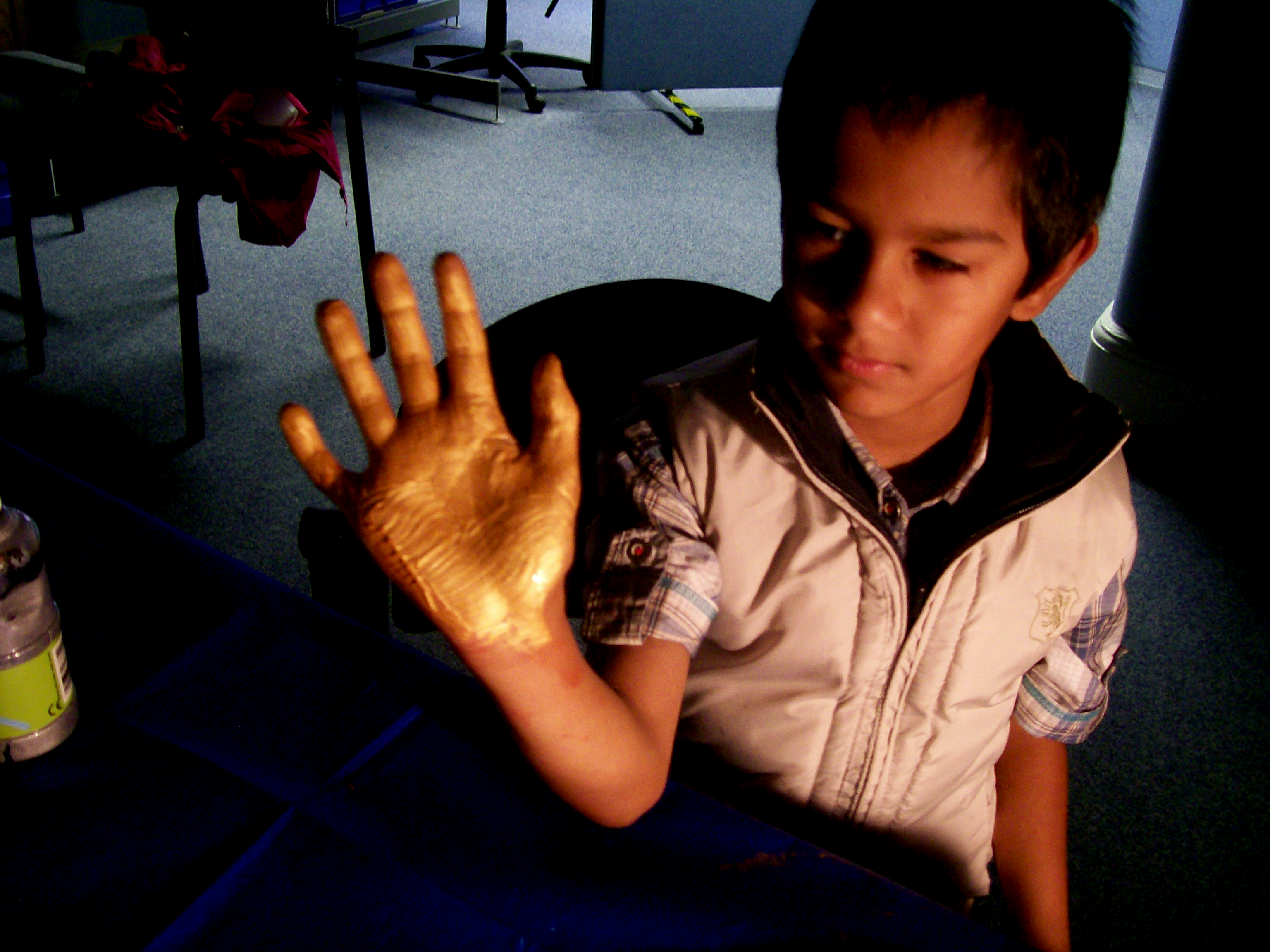 Child holding up hand with palm painted bronze