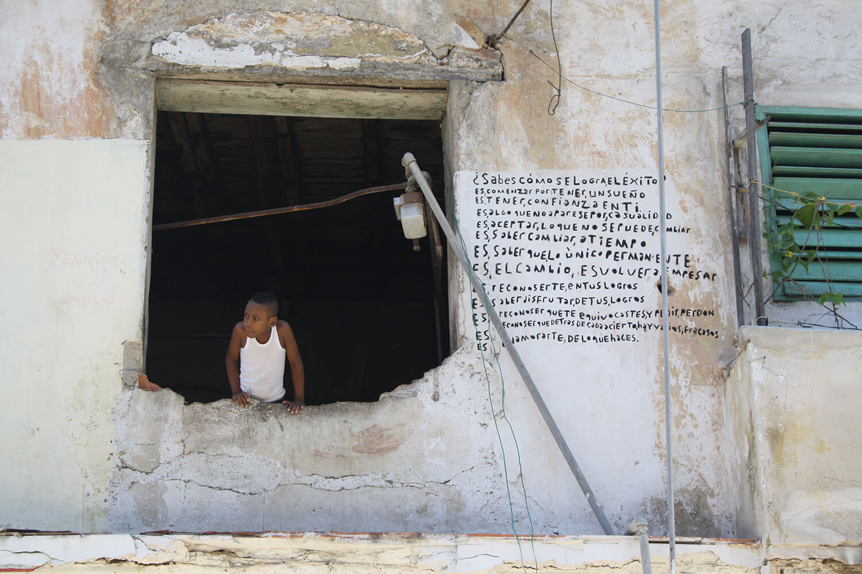 Camara Chica: Boy at window